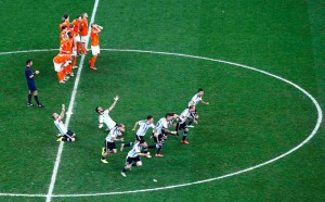 Argentina's players celebrate past the Netherlands' players after winning their 2014 World Cup semi-finals at the Corinthians arena in Sao Paulo
