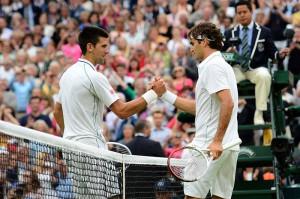 Roger-Federer-shakes-hand-swith-Serbias-Novak-Djokovic-after-his-mens-singles-semi-final-victory