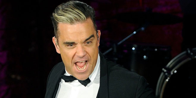 robbie williams casse le bras d'une fan lors d'un concert