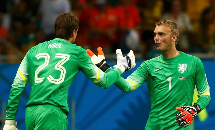 Goalkeeper Tim Krul of the Netherlands goes in for team mate Jasper Cillessen during extra time in their 2014 World Cup quarter-finals against Costa Rica at the Fonte Nova arena in Salvador