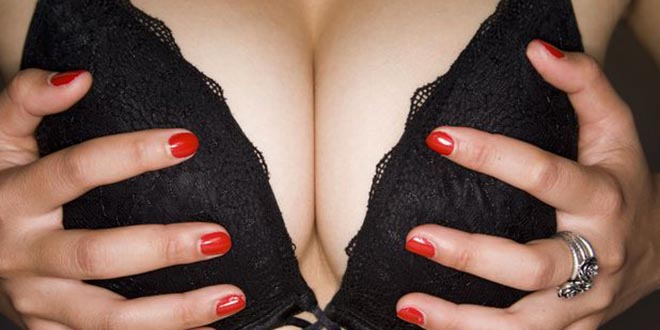 lady-holds-breasts
