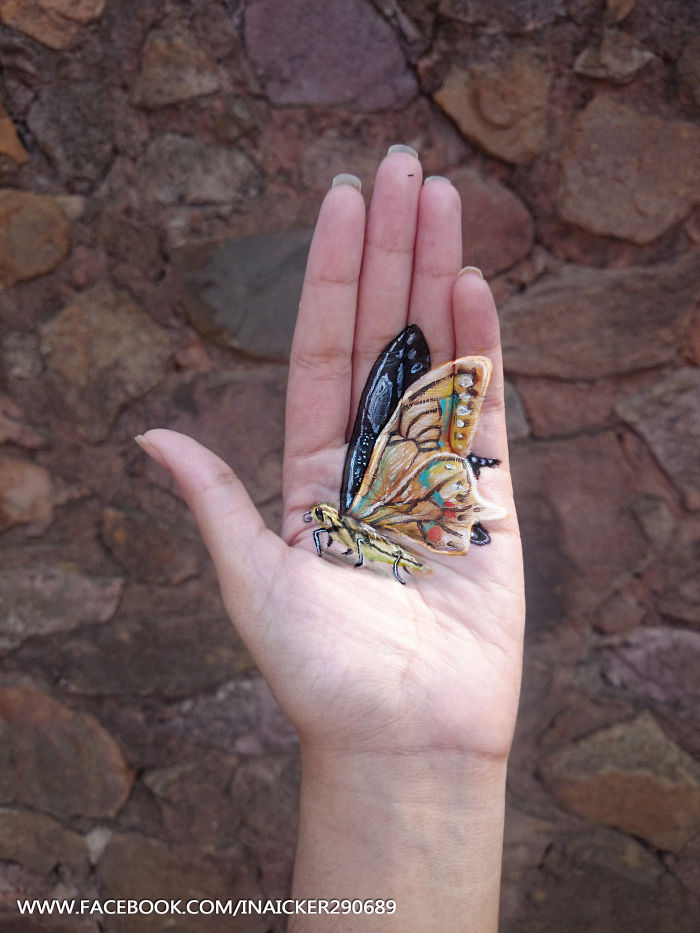 elle-peint-des-peinture-3D-dessins-3D-sur-sa-main